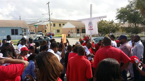 Liberty City protesters walk along Northwest 62nd Street near the Liberty Square housing projects where many of Liberty City's killings take place.