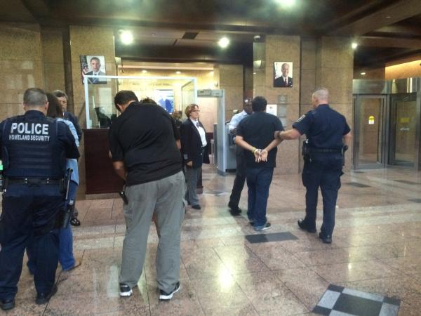 Eight protesters were arrested for civil disobedience after the building closed and they refused to leave.