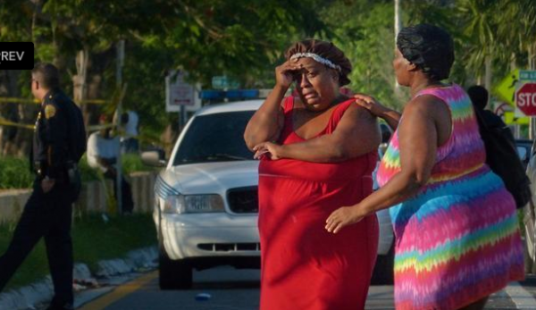 Hermana Richardson, left,  arrives to the scene of the June 24 Liberty City mass shooting.  Kevin Richardson, her son, was killed.