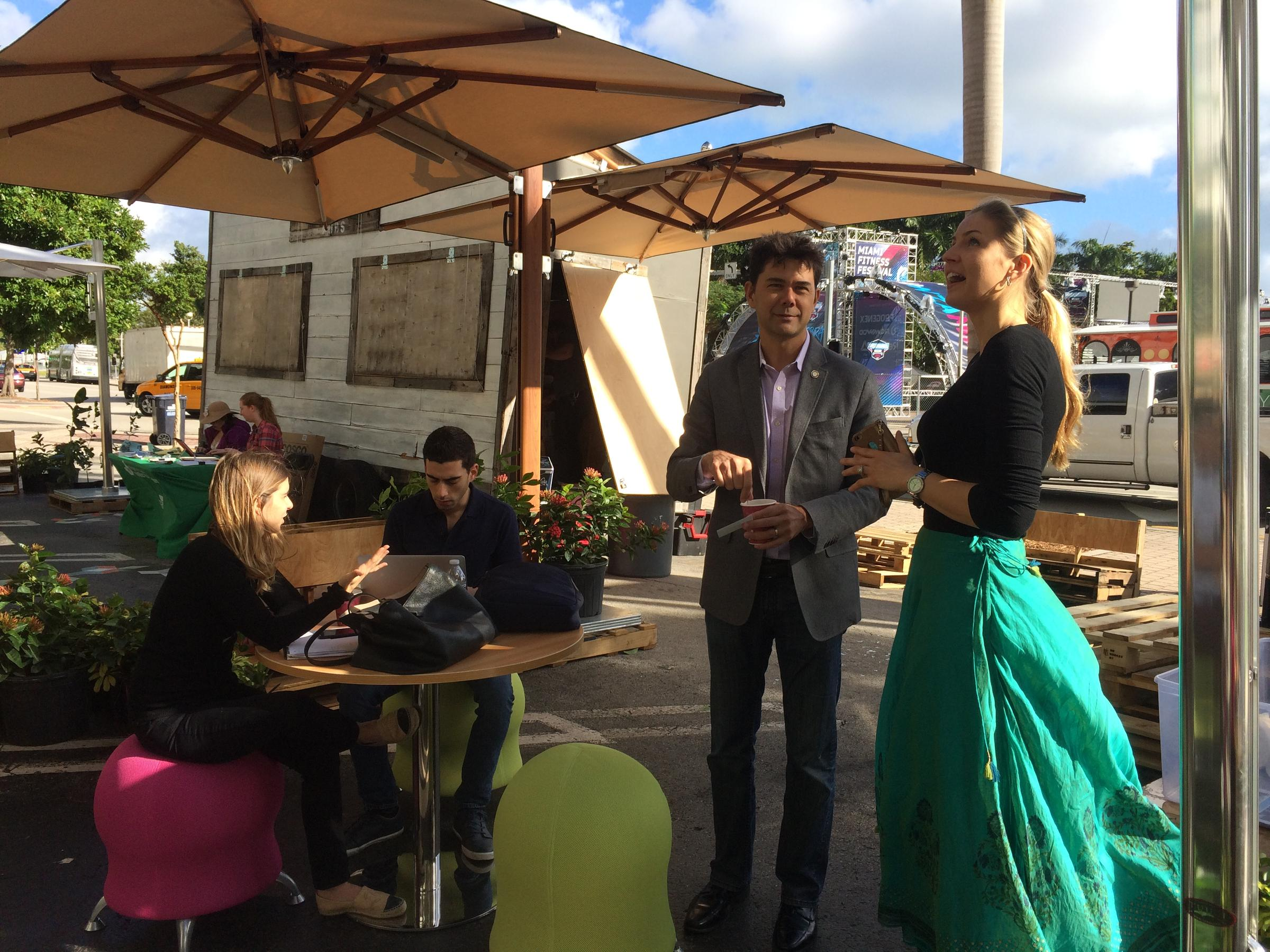 Injecting green space to make way for pedestrians on biscayne ken russell district 2 commissioner for the city of miami and oksana klimovich of synergy workspaces chat at the biscayne green pop up park in downtown xflitez Image collections