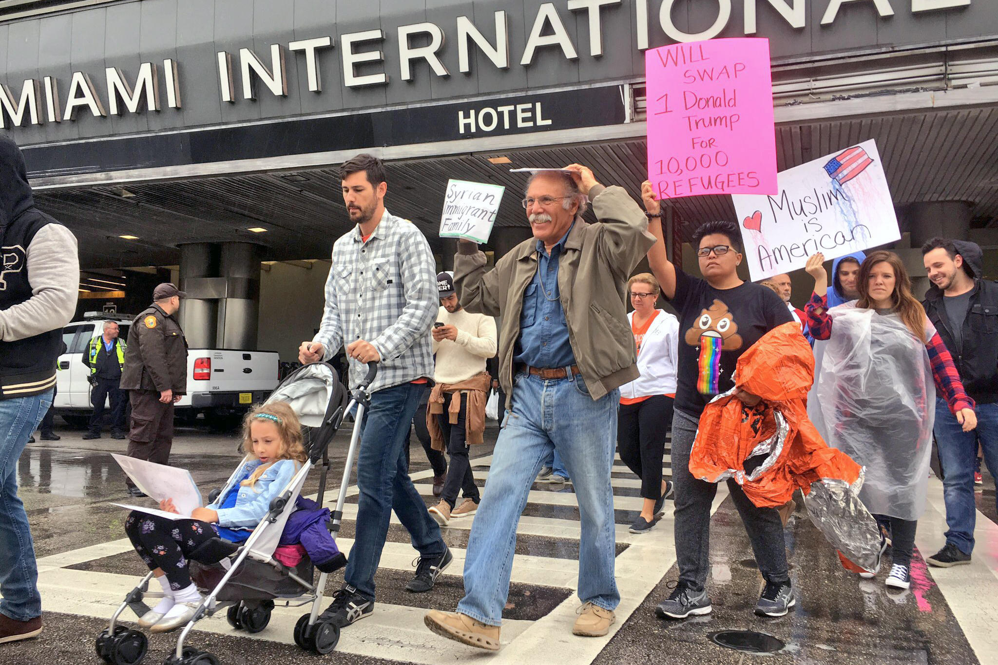 Syrian family decries trumps ban on refugees - A Family With Syrian Roots Protest Against Trump S Executive Order To Limit Refugee From Entering The U S At Miami International Airport On Jan 29 2017
