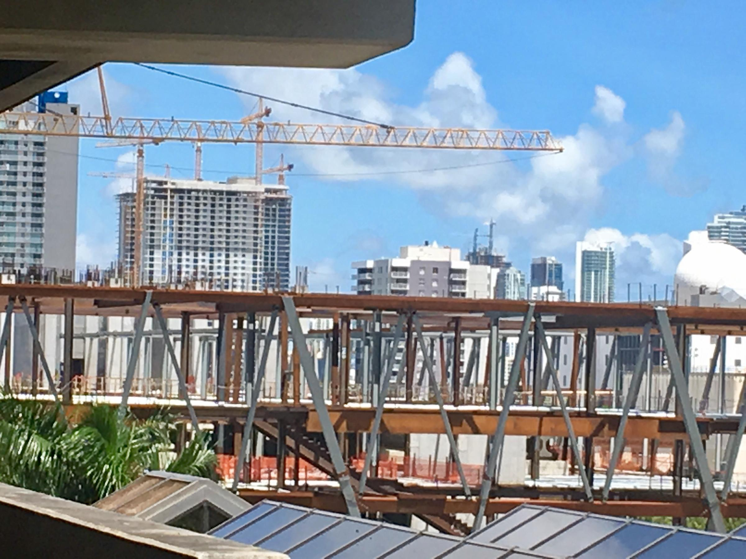 Huge crane atop Downtown Miami high-rise collapses in Irma's winds