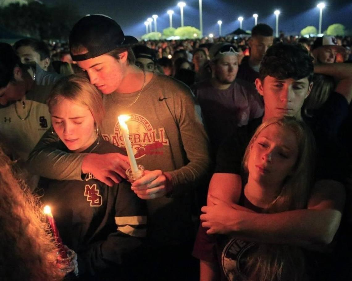 Students mourn at last week's vigil for the 17 victims of the Marjory  Stoneman Douglas High