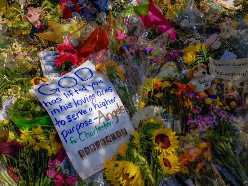 Flowers, notes, and other items placed as memorials to the slain outside Emanuel A.M.E. Church in Charleston in June, 2015.