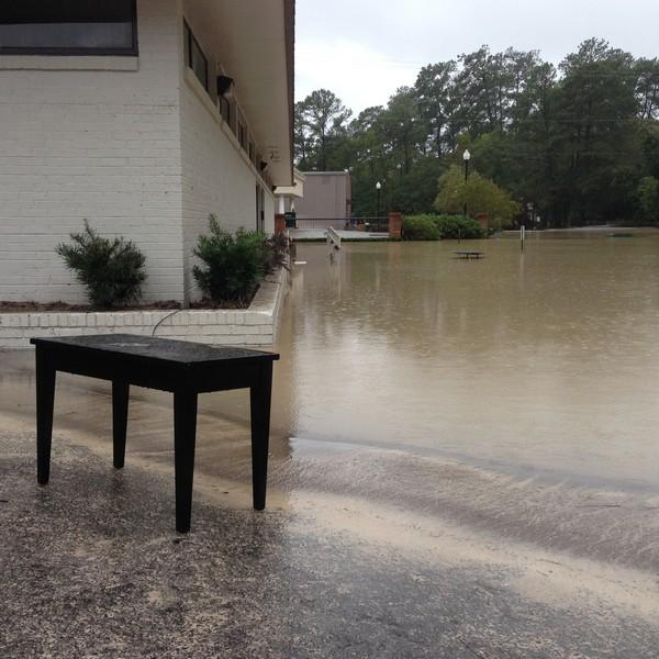 Flooding at the Columbia Classical Ballet, Oct. 5, 2015. The piano that goes with this bench was floating inside the building.