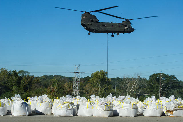 Initial repair efforts at the Columbia Canal required the SC National Guard to lift giant sandbags into the breach.