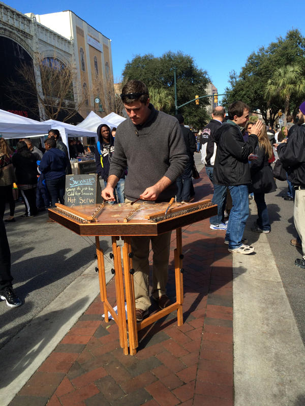 treet musician Matthew Dickinson plays his hammered dulcimer on a bright Saturday morning at the Soda City Market on Columbia's Main Street.