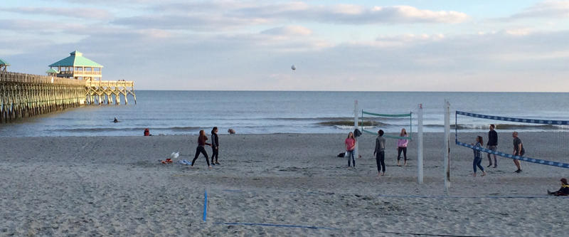 These volleyball enthusiasts at Folly Beach are playing on 18 percent less sand than was on the beach prior to the historic floods and high tides of Oct 4, 2015.