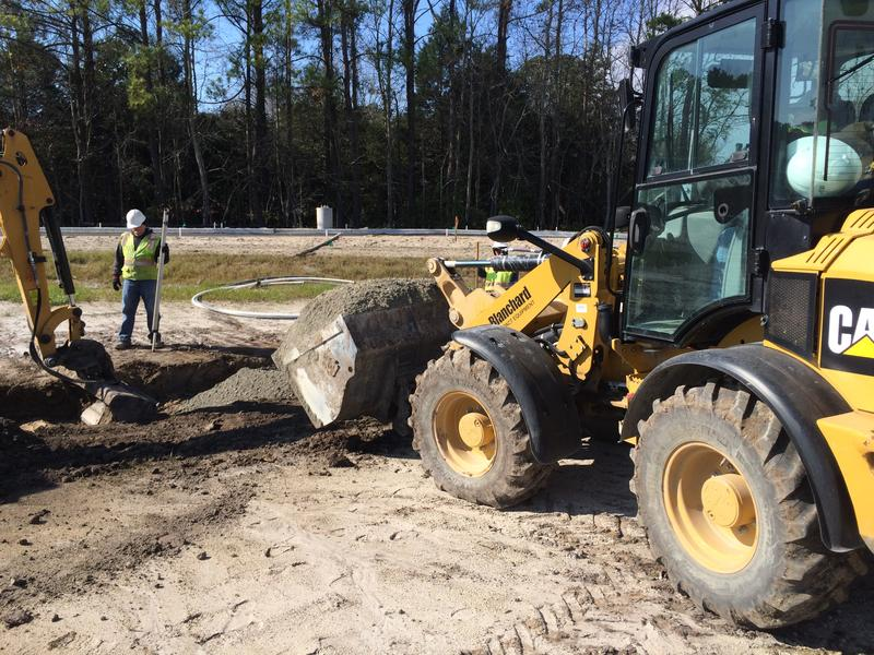 Backhoes and bulldozers prepare the ground for new business locations in Myrtle Beach.  The area has been named one of fastest metropolitan statistical areas in the nation, drawing both business and residents to Horry County.
