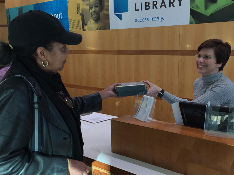 Despite the inroads made by technology, friendly personnel are still on hand to check out materials to the public at Richland Library.