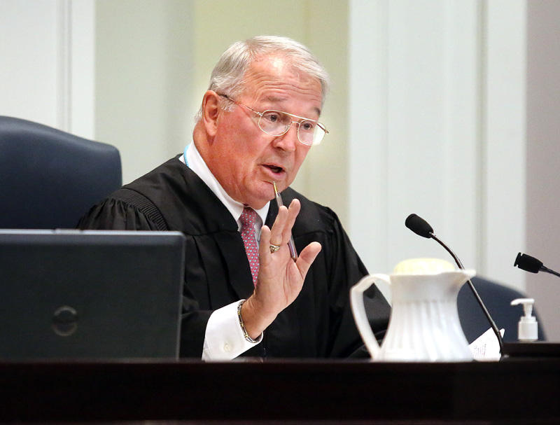Circuit Judge J.C. Nicholson questions attorneys Wednesday at the Charleston County courthouse before he approved a delay in Dylann Roof's murder trial.