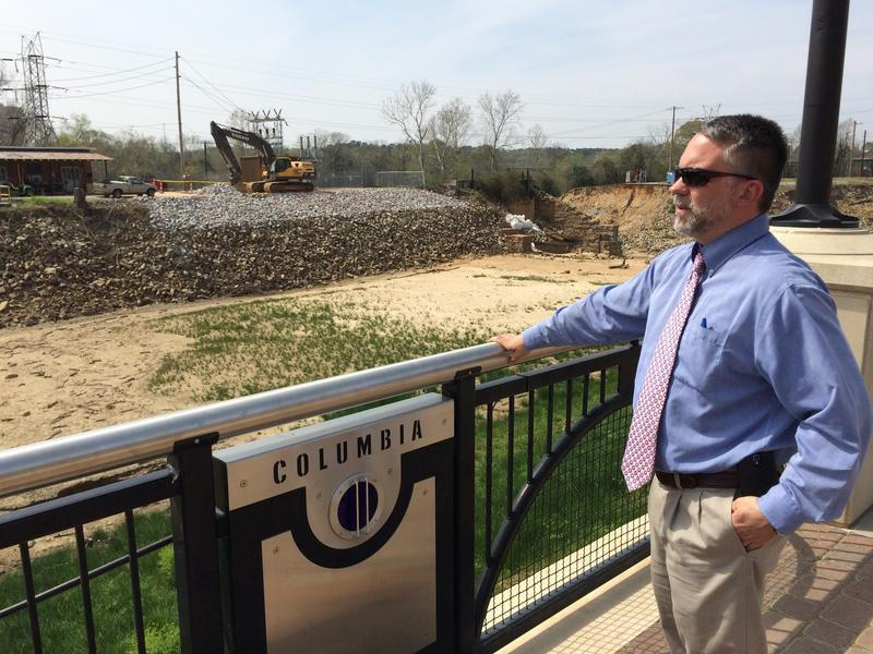 Columbia Director of Utilities and Engineering Joey Jaco surveys the empty end of the Columbia Canal.  Above his right elbow can be seen the breach which emptied the canal's water into the Congaree River.