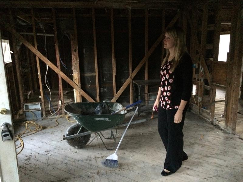 Lindsay Langdale surveys the stripped-down lumber supporting her house after required mold remediation had been done.