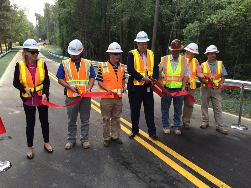 A South Carolina Dept. of Transportation crew reopens the Drawdebil Road bridge in Lexington County.