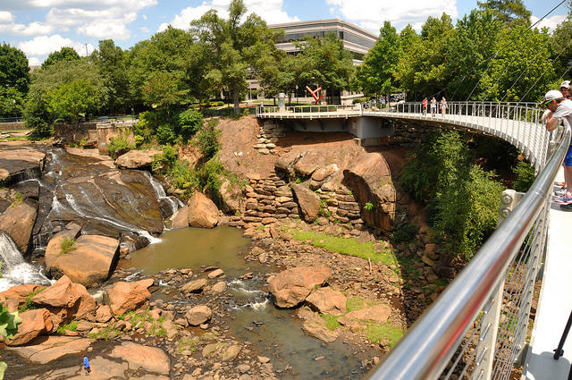 "Falls Park in downtown Greenville, SC. The city's next planned revitalization project is another ""world-class"" park along the Reedy River."