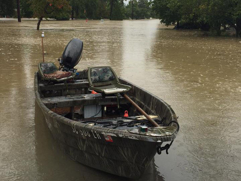 The Latham family was rescued by neighbors in jon boats like this one. The water rose high enough to cover cars and street signs, and flowed so fast that only jon boats could navigate the water.