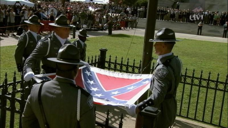 State Troopers removing the Confederate battle flag from display on the grounds of the South Carolina State House, July 10, 2015.