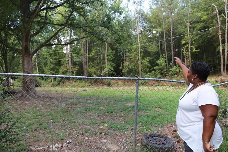 Janey Heath standing in her backyard