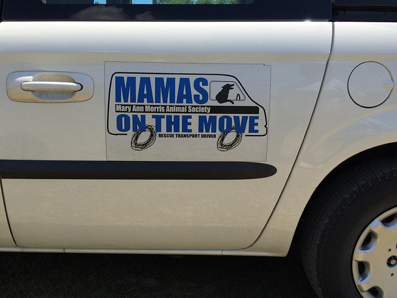 A volunteer's transport van bears the slogan MAMAS on the Move.