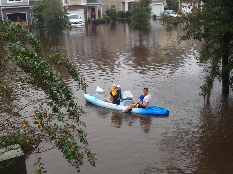 The Kelly family evacuates their home in Johns Island via kayak, October, 2015.