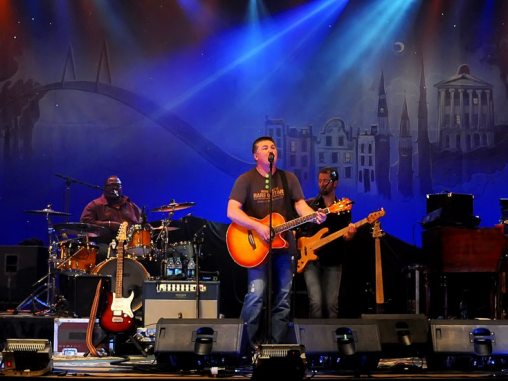 Edwin McCain and his band on stage at the Charleston Music Hall.