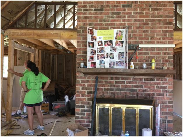 Volunteers work on Flood-damaged house