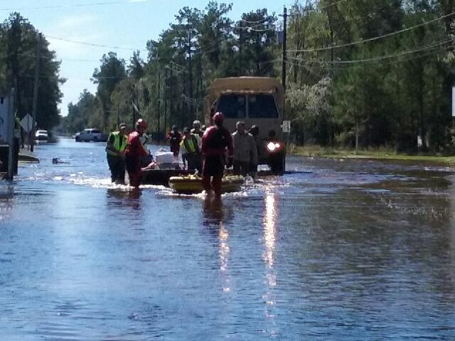 Boats and trucks were used to evacuate residents from flood waters