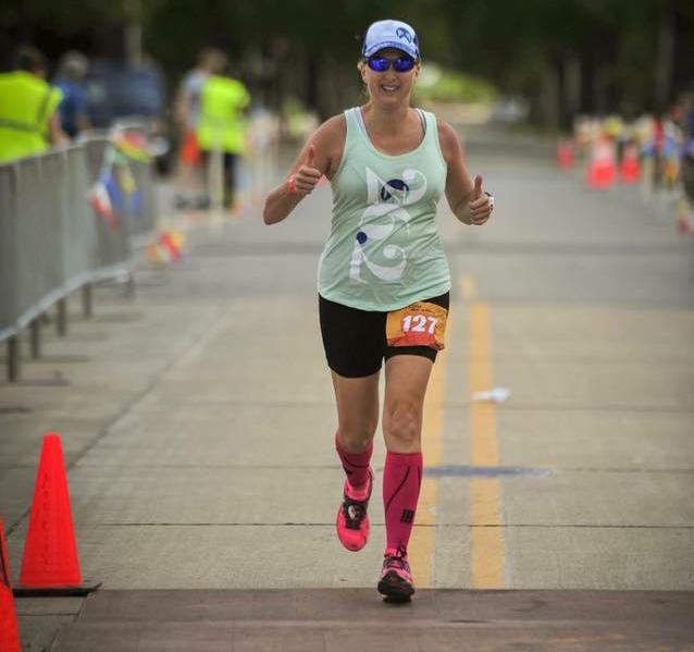 West Columbia's Elizabeth Gray is running marathons in all 50 states to call attention to the problem of domestic violence.   Her story has made her a finalist for the cover of Running World magazine.