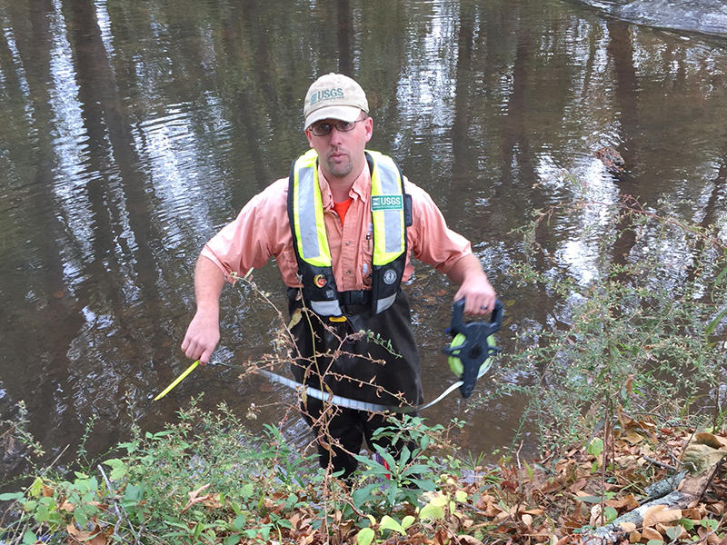Philip Habermehl of the U.S Geological Survey measures streamflow in the Reedy River south of Greenville, SC.