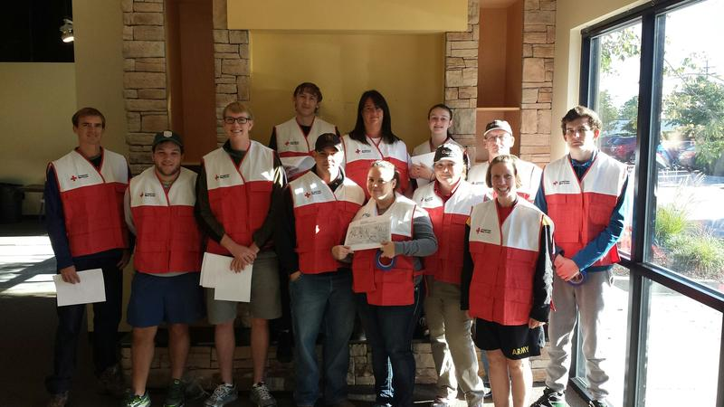 Fort Jackson VolunTEENS and USC students teamed up to distribute flyers to hard-hit areas across the Midlands. October 17, 2015
