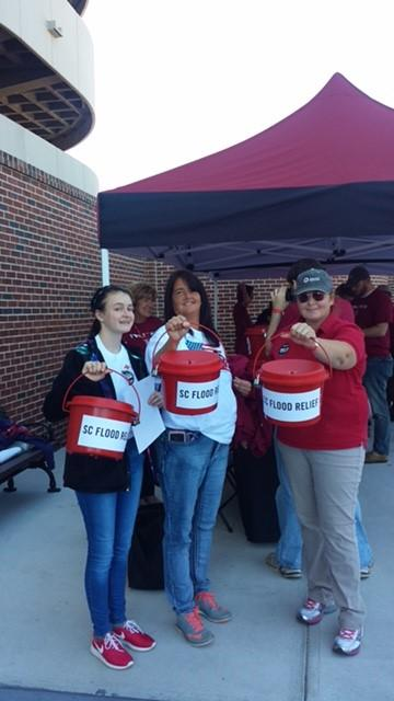 VolunTEENS joined the United Way to collect flood relief donations outside the Williams-Brice Stadium before the game. October 17, 2015