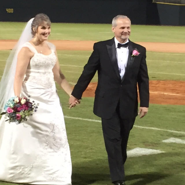 Mr. and Mrs. Mark Cain got a free wedding at Columbia's new minor league baseball park, thanks to a class of University of South Carolina students.