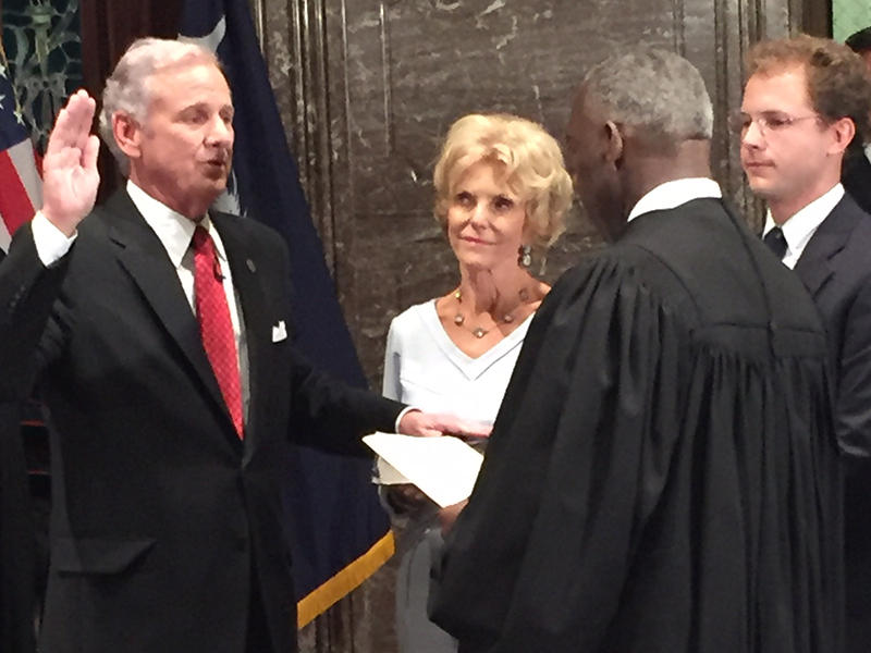 Gov. Henry McMaster with his wife Peggy, and son Henry is sworn into office by S.C. Supreme Court Chief Justice Donald Beatty at the Statehouse on Tuesday, January 24, 2017.