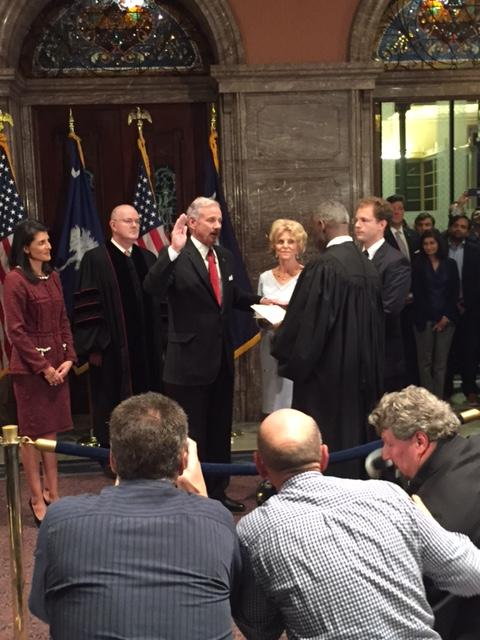 Lt. Governor Henry McMaster places his hand on the Bible as Chief Justice Don Beatty swears him in to be the 117th governor of South Carolina.
