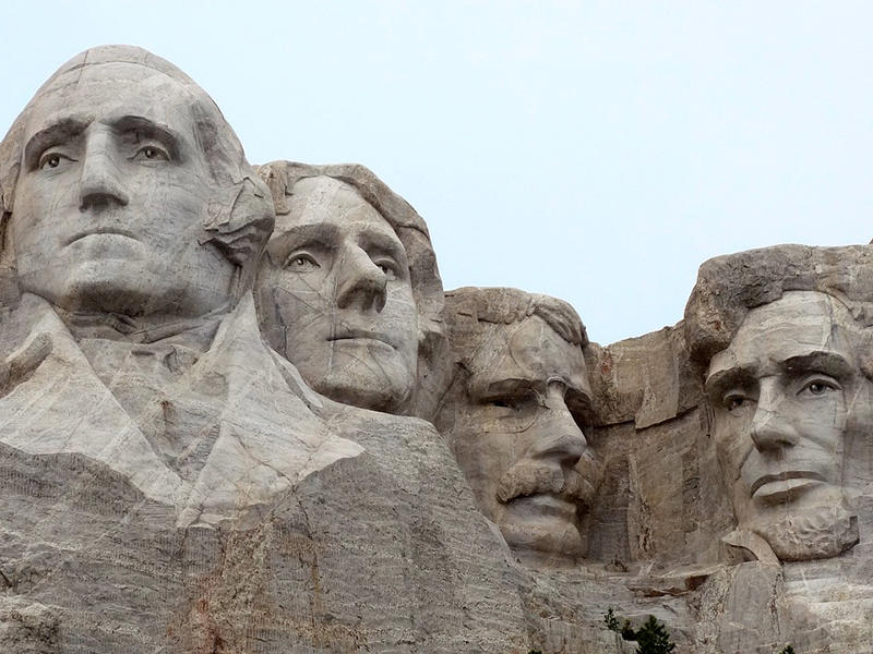 Faces of past U. S. Presidents carved into Mt. Rushmore in South Dakota.