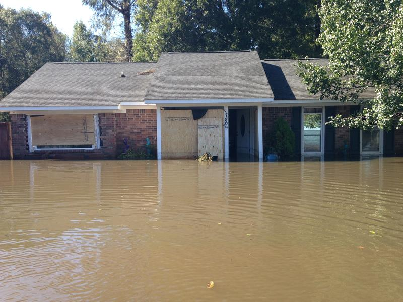 Rainfall from Hurricane Matthew in October 2016 flooded the street and homes in the Pepperhill neighborhood.