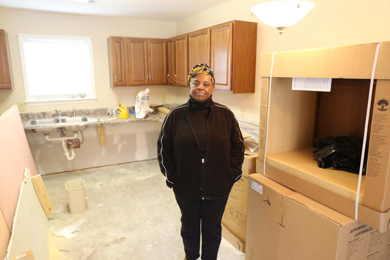 Mullins resident Barbara Sellers stands in an apartment being renovated again after Hurricane Matthew flooded the area in October 2016.