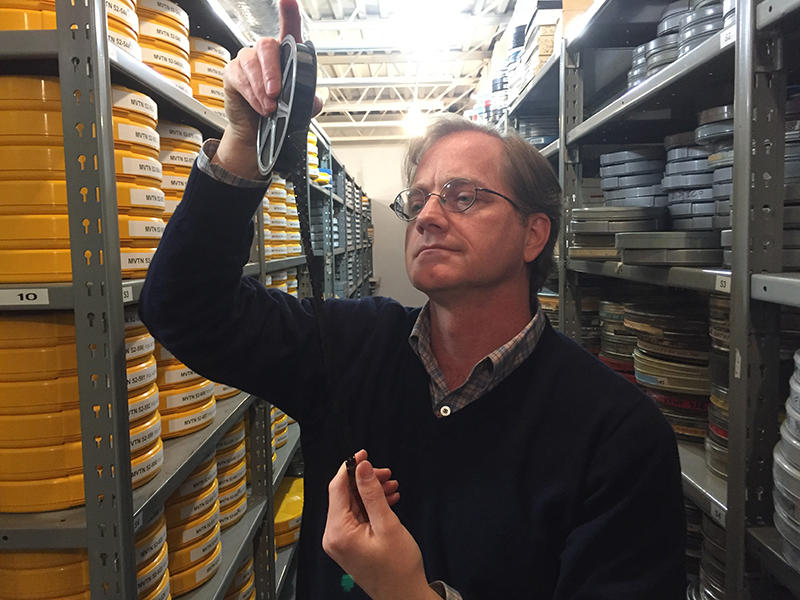 Greg Wilsbacher, checking film in USC's Moving Image Research Collection.