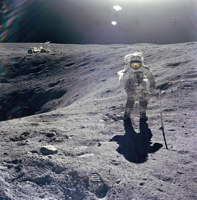 (April 21, 1972) Astronaut Charles M. Duke Jr., Lunar Module pilot of the Apollo 16 mission, is photographed collecting lunar samples at Station no. 1 during the first Apollo 16 extravehicular activity at the Descartes landing site.