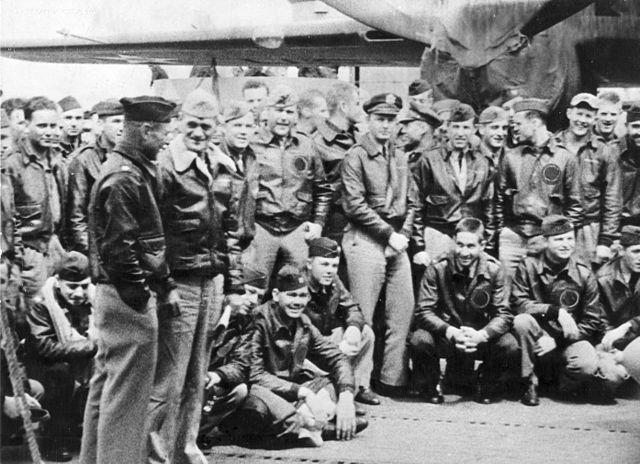Orders in hand, Navy Capt. Marc A. Mitscher, skipper of the USS Hornet (CV-8) chats with Lt. Col. James Doolittle, leader of the Army Air Forces attack group. This group of fliers carried the battle of the Pacific to the heart of the Japanese empire.