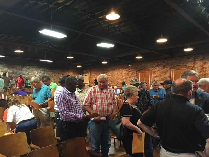 During a 2016 town hall meeting, Williamsburg County residents learn about the state's flood recovery program. Officials report the program is on track to help 1500 households.