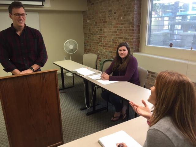 Charleston School of Law student Tyler Gilliam rehearses his tax argument with Prof. Kristin Gutting as his partner Anna Boning looks on.  Gutting coached the students to the school's sixth consecutive tax moot court national championship.