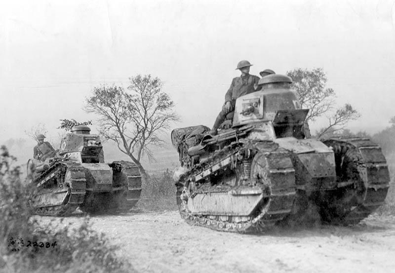 American troops going forward to the battle line in the Forest of Argonne. France, in Renault FT tanks. Light tanks with a crew of only two, these were mass-produced during World War I.