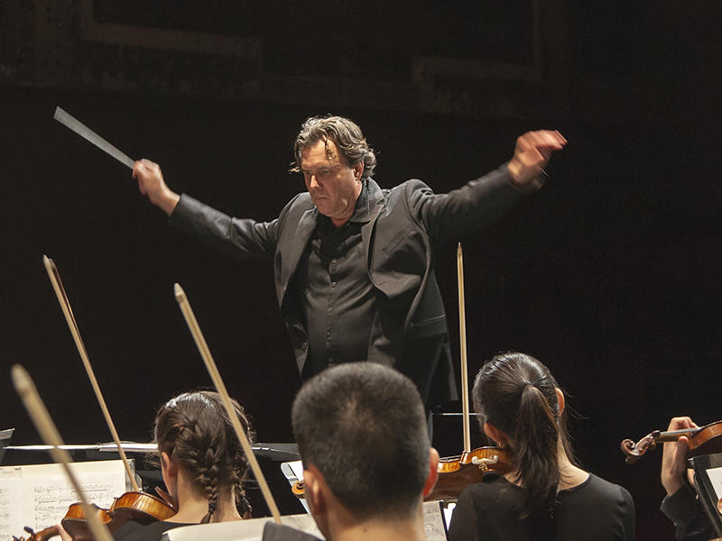 Festival Resident Conductor and Director of Orchestral Activities John Kennedy leads the Spoleto Festival USA Orchestra.