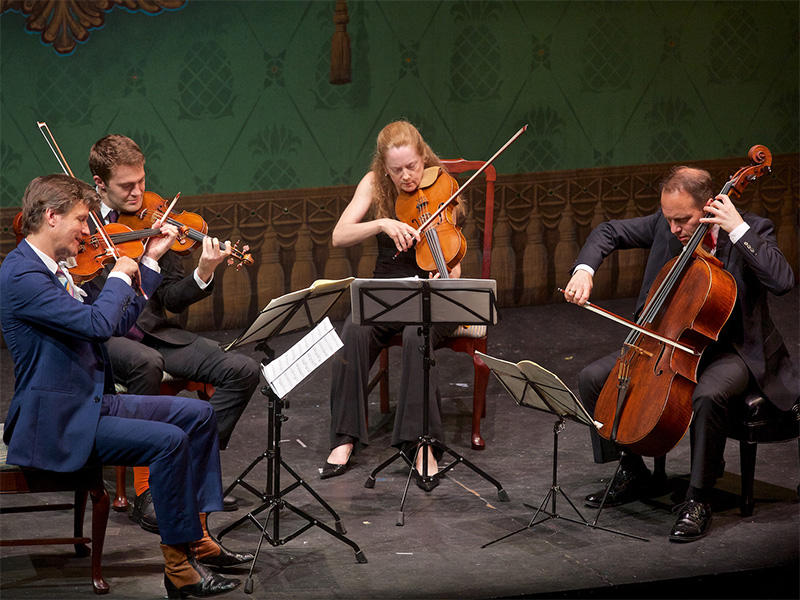 Director and violinist Geoff Nuttall (far left) directs and hosts the Bank of America Chamber Music Series at the Dock Street Theatre, featuring the St. Lawrence String Quartet.