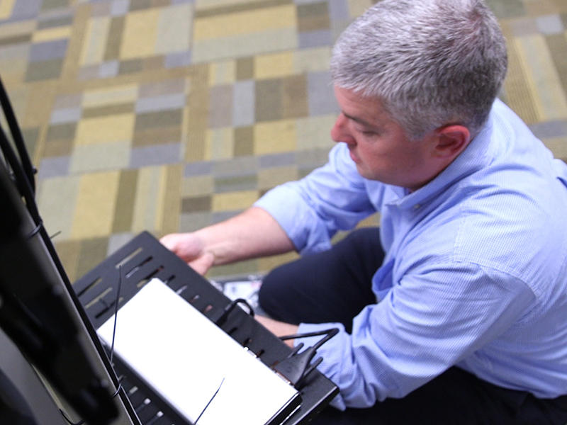 Palmetto Care Connection's Technology Director assembles a telehealth cart in Columbia, South Carolina.