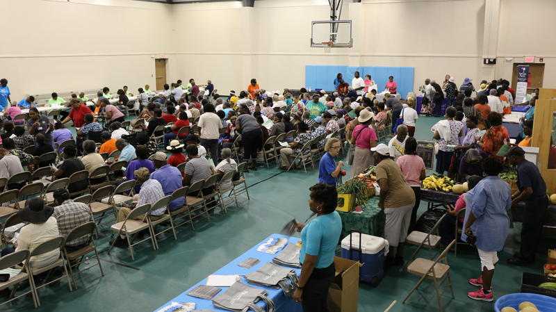 Hundreds of Williamsburg County seniors during Senior Market Day in Kingstree to receive vouchers for fresh fruits and vegetables from certified farmers.