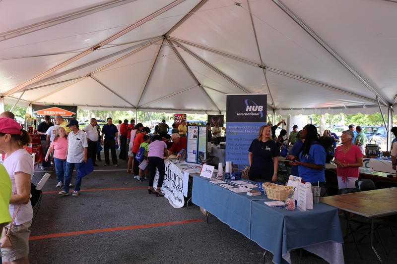 Vendors stand with displays at their designated tables at the Expo.