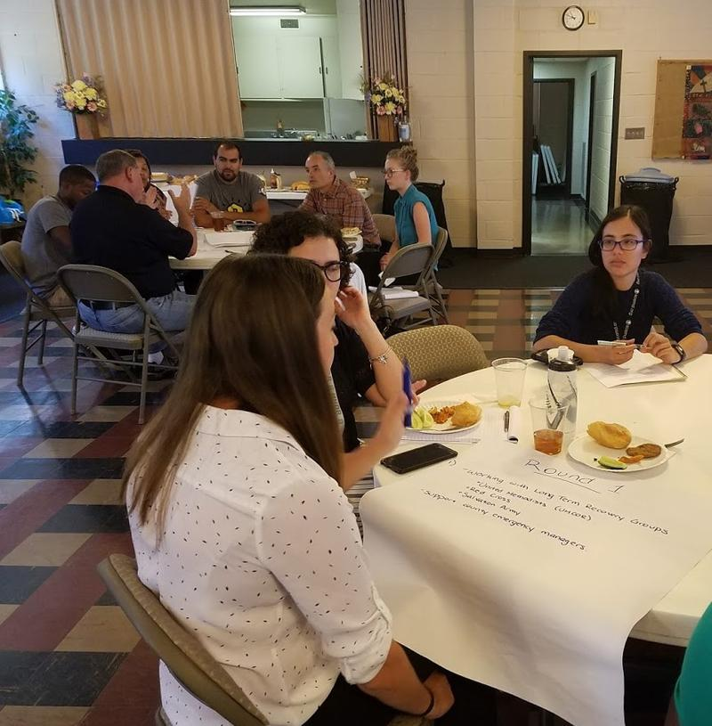 Participants in the focus group held at St. Mark United Methodist Church in Columbia brainstorm how to reach volunteers for the ongoing flood recovery efforts.