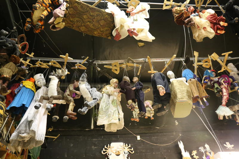 Puppets line the ceiling and walls backstage at the Columbia Marionette Theater.